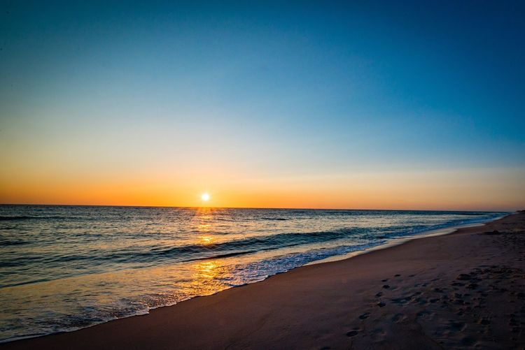 Sea Scenics Sunset Horizon Over Water Beauty In Nature Beach Nature Water Tranquil Scene Tranquility Sand Idyllic Sky Clear Sky No People Outdoors Wave Blue Day