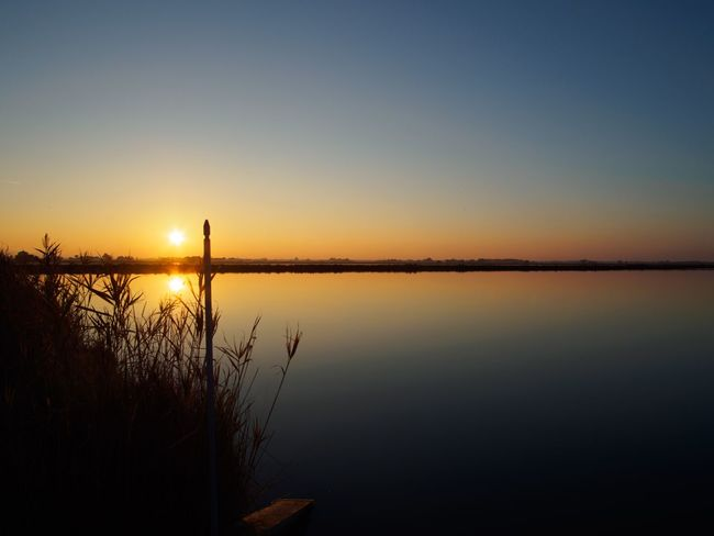 Sunset Water Tranquility Reflection Nature Sky Beauty In Nature Outdoors No People Day Landscape Landscapes Silence Gradient Gradiented Sky EyeEmNewHere