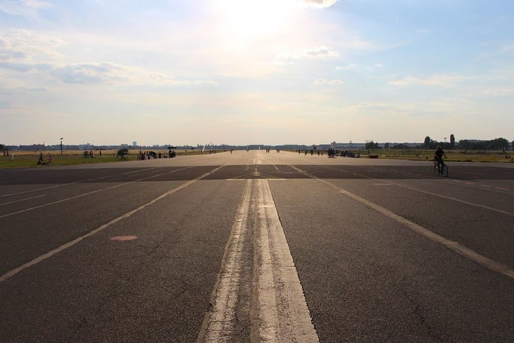 The abandoned airstrip at Tempelhofer Feld, Berlin. Airport Diminishing Perspective Leisure Activity Park Relaxing Road Skies Sky Summer Summertime Sunny Day Tempelhof Tempelhofer Feld The Road Ahead The Way Forward Vanishing Point