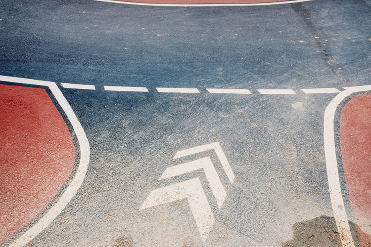 High angle view of road sign on street