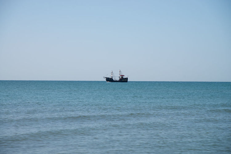 Nautical vessel in sea against clear sky