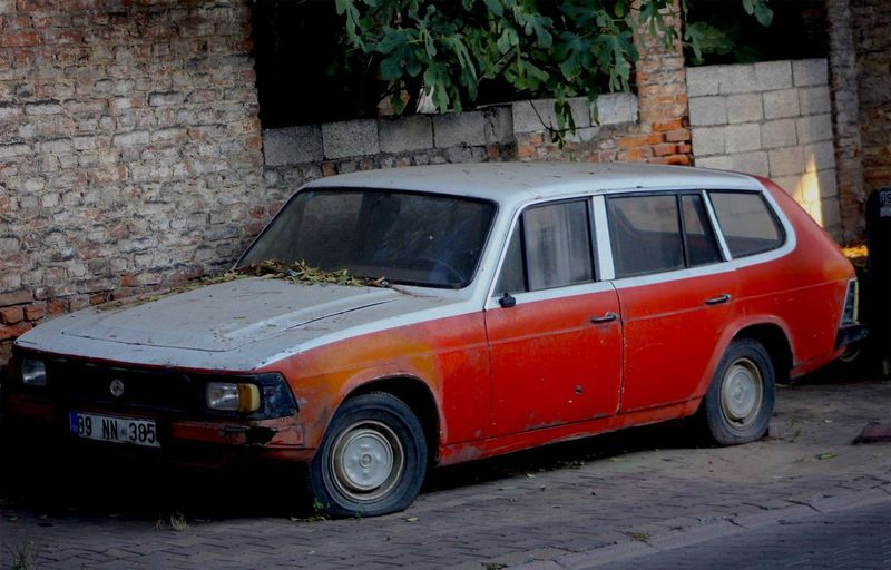 Vintage car on street against wall
