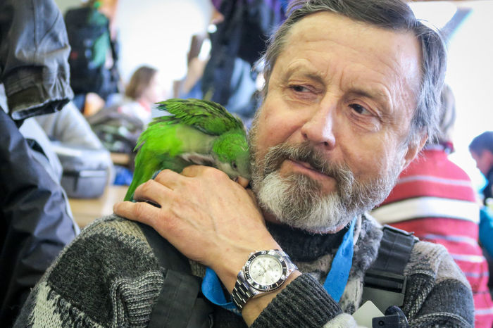 Skimates Bill and Rudy Birds Friendship Green Parrot Headshot Loyal Pets Loyalty Parrot Parrot Lover Pet Portrait Real People Senior Adult Whitewater The Portraitist - 2017 EyeEm Awards Pet Portraits