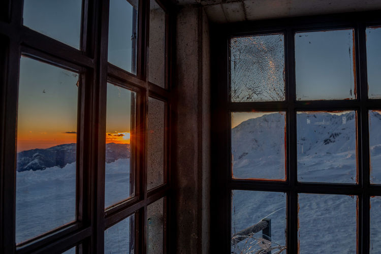Sea seen through glass window during winter