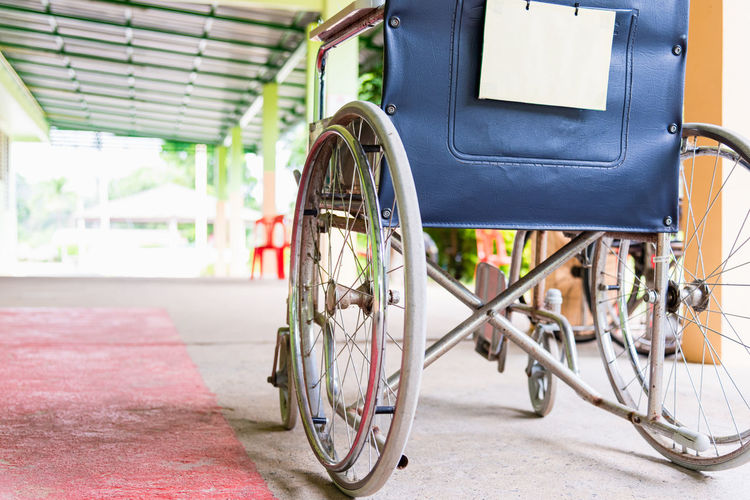 Close-up of empty wheelchair parked in hospital