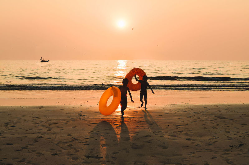 Children On Beach At Sunset