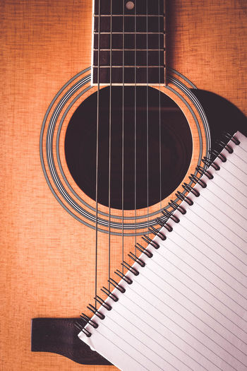 Acoustic Guitar Arts Culture And Entertainment Brown Close-up Guitar High Angle View Indoors  Music Musical Equipment Musical Instrument Musical Instrument String No People Paper Pattern Piano Spiral Still Life String String Instrument Wood - Material
