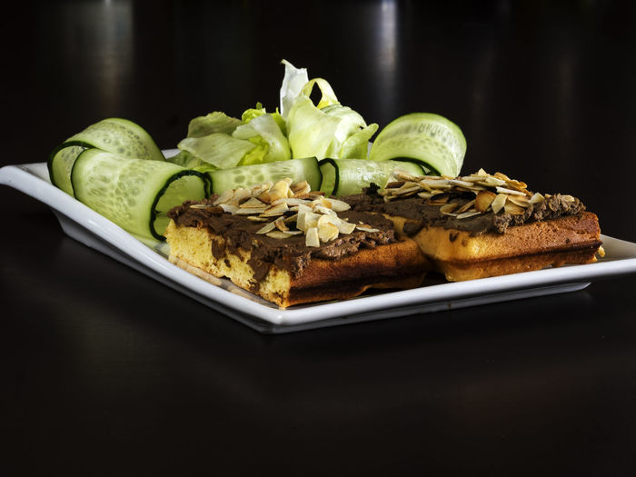 Liver pate on a Belgian waffle Belgian  Black Background Close-up Day Food Food And Drink Freshness Healthy Eating Indoors  Liver No People Pate Plate Ready-to-eat SLICE Table Waffle
