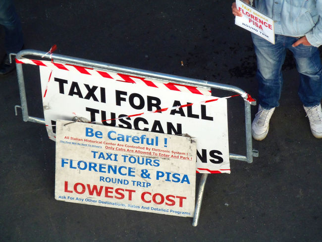 Dockside, Livorno cruise terminal, Taxi rank Florence, Italy Be Careful Close-up Communication Day Livorno Italy Low Section Lowest Cost Men Outdoors People Pisa, Italy Real People Standing Taxi For Hire Taxi Rank Text Two People Western Script