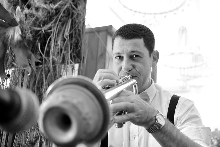 EyeEm Best Shots Eye4photography  Getting Inspired Music Musician Musical Instrument One Person Portrait Selective Focus Trumpet Front View Headshot Skill  Arts Culture And Entertainment Hairstyle Blackandwhite Monochrome