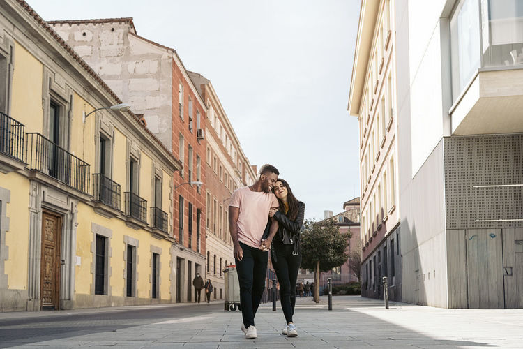Couple standing on road in city