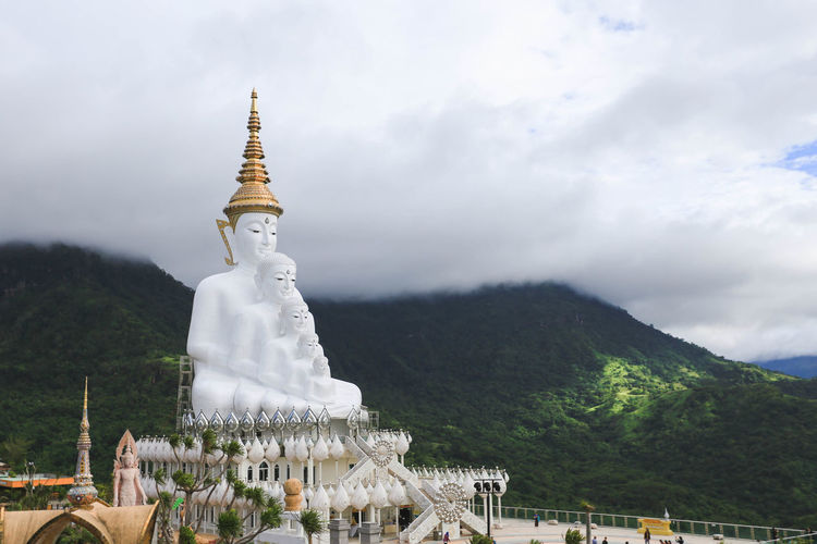 Statue by mountain at temple