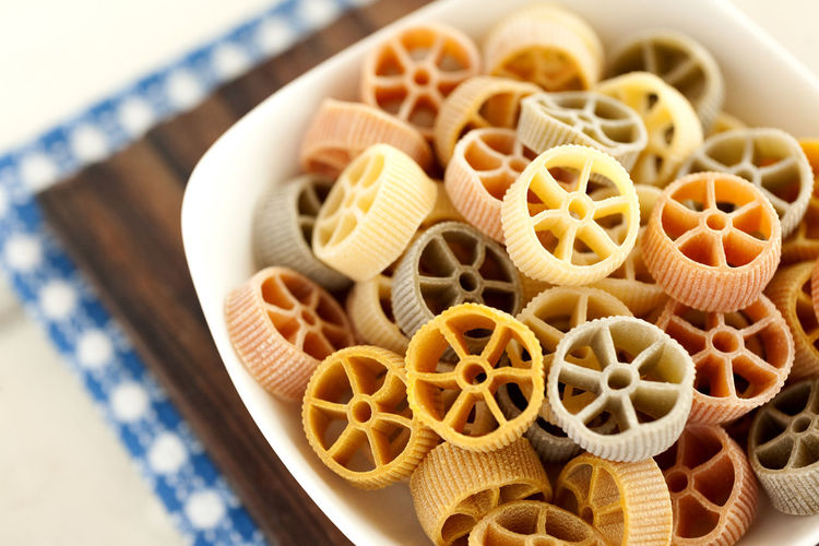 Multicolor Rotelle pasta. Dry Italian pasta. Italian Pasta Noodles Bowl Classic Food Close-up Dry Pasta Food Food And Drink High Angle View Italian Food Multicolor Pasta No People Pasta Rotelle Rotelle Pasta Still Life Table Traditional Food