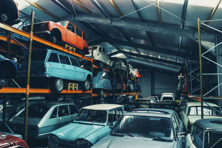 old Classic cars in a garage hall Car Park Classic Classic Car Classic Cars Workshop Car Chrome Collectibles Cruising Day Engine Garage Grunge Indoors  Land Vehicle Metal No People Oldtimer Scrap Spare Parts Stacked Transportation Vintage Vintage Cars Youngtimer