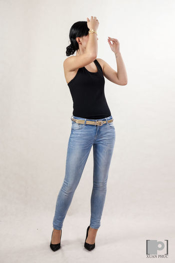 model Attitude Black Tshirts Casual Clothing Fashionable Front View Full Length Leisure Activity Lifestyles Looking Down Person Standing Studio Studio Photography Studio Shoot Studio Shot T-shirt White Background Women Who Inspire You Young Adult Young Women