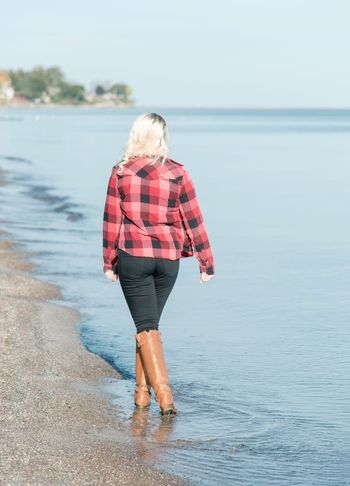 Young woman in beach Only Women Blond Hair One Person Rear View Full Length Adults Only Casual Clothing Sea Water Walking Beach Leisure Activity