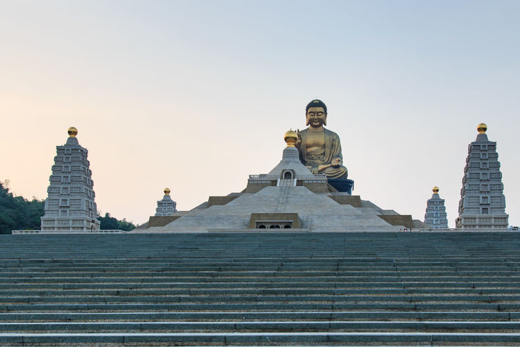 Low Angle View Of Buddha Statue At Fo Guang Shan Against Clear Sky