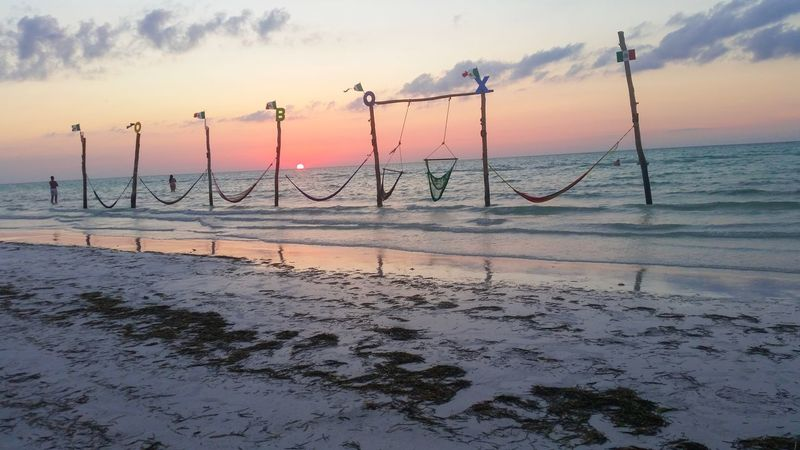 Sunset in the beach Summer Travel Destinations Vacations Holbox Island Holbox Sky Water Cloud - Sky Beach Sunset Sea Tranquility Reflection Idyllic Outdoors Orange Color Non-urban Scene Horizon Over Water No People Sand Tranquil Scene Land Beauty In Nature Nature Scenics - Nature