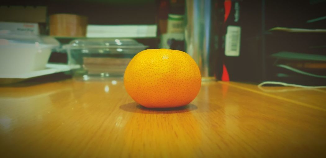 Close-up of orange on table at home