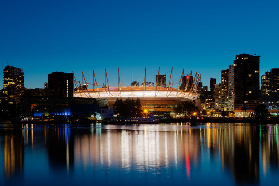 BC Place BC Place Vancouver Architecture Blue British Columbia Building Exterior Built Structure Canada City City Life Cityscape Clear Sky Illuminated Modern Night No People Outdoors Reflection River Sky Skyscraper Urban Skyline Water Waterfront