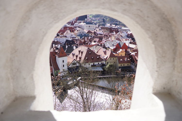 View of townscape seen through window of building