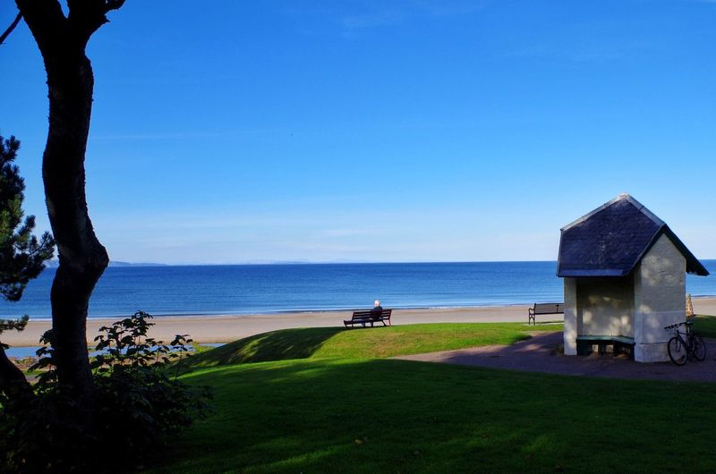 Take time to reflect Nature Beauty In Nature Scenics Tranquil Scene Grass Tranquility Sea Clear Sky Day Growth Tree No People Blue Outdoors Water Landscape Beach Architecture Sky Horizon Over Water Nairn Scotland Scottish Highlands Highlands Visit Scotland