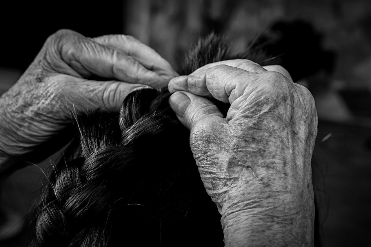 Cropped Hands Tying Hair