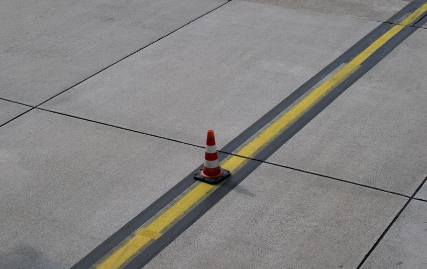 Airport Airport Markings Airportphotography Architecture Cone Day From An Airplane Window High Angle View Nature One Person Outdoors People Road Markings Taxiway Transportation Travel Runway No People Traffic Cone