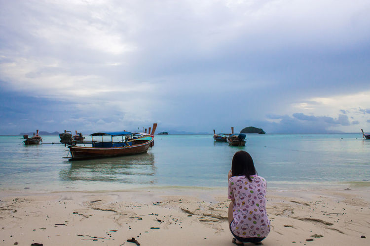 Sea Beach Beauty In Nature Cloud - Sky Horizon Horizon Over Water Land Mode Of Transportation Nature Nautical Vessel One Person Outdoors Real People Rear View Sand Scenics - Nature Sea Sky Tranquil Scene Tranquility Transportation Water