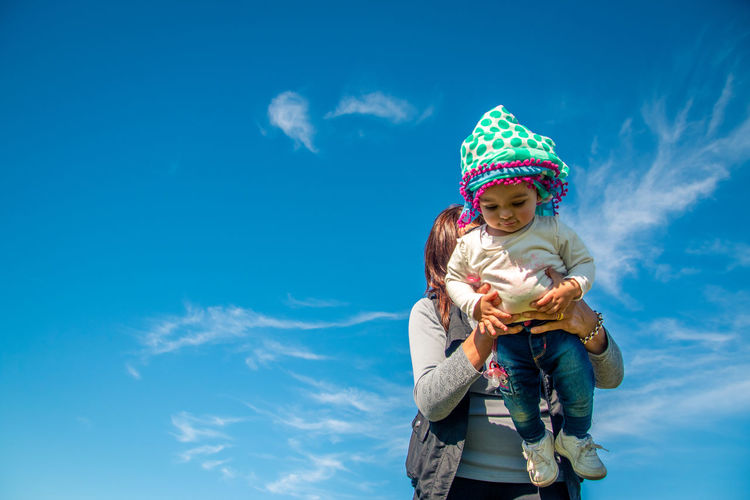 Outdoors Outdoors Photograpghy  Lifestyles Lifestyle Childhood Child Sky Cloud - Sky Females Innocence Women Front View Leisure Activity Girls Real People Clothing Day Nature Hat Cute Three Quarter Length Standing Two People Warm Clothing