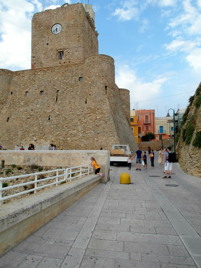 View of the castle of Termoli Termoli  Ancient Civilization Architecture Building Exterior Built Structure Clock Clock Tower Clouds Clouds And Sky Heritage Building History Italy Molise Outdoors Real People Street Tower Travel Destination