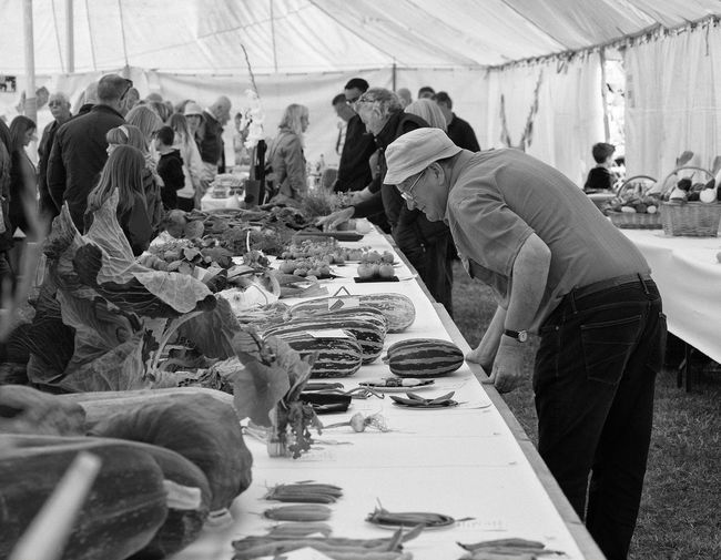 Country Show Vegetables Real People Men Group Of People People Crowd Occupation Day Working Food And Drink Women Adult Business Food Market Table Messy Lifestyles Market Stall Street Market