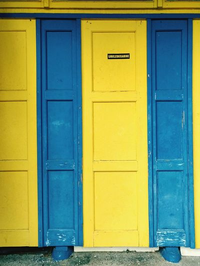 EyeEm Selects Umkleidekabine Umkleide Garderobe Sverige Sweden Yellow Blue Closed Door Changing Room Locker Room Cubicle Changing Cubicle Doors Swimming Bath Bath Lido Open Air Bath Yellow Door Blue Door Ankleidezimmer Kabine Cabinet Cupboard