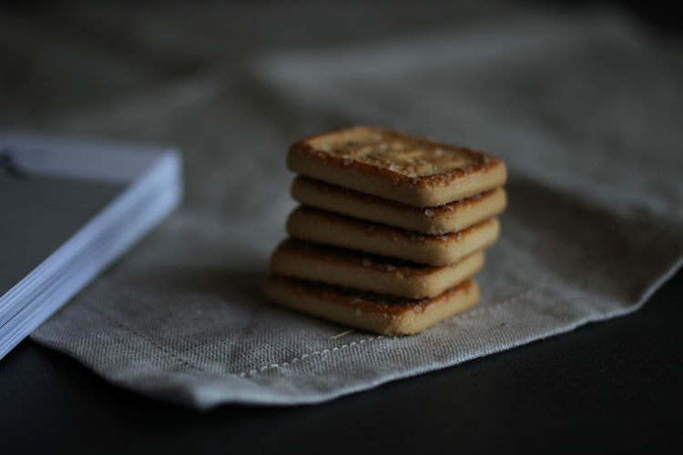 Close-up of biscuits on napkin at table