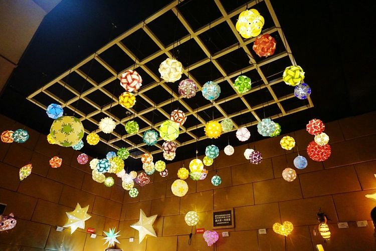 Illuminated Low Angle View Hanging Ceiling Lighting Equipment Decoration Indoors  Multi Colored Night Modern Light Fixture Culture Lantern Decor Geometric Shape Repetition Electric Light Green Color City Life Arrangement Taiwan Tainan City Creativity