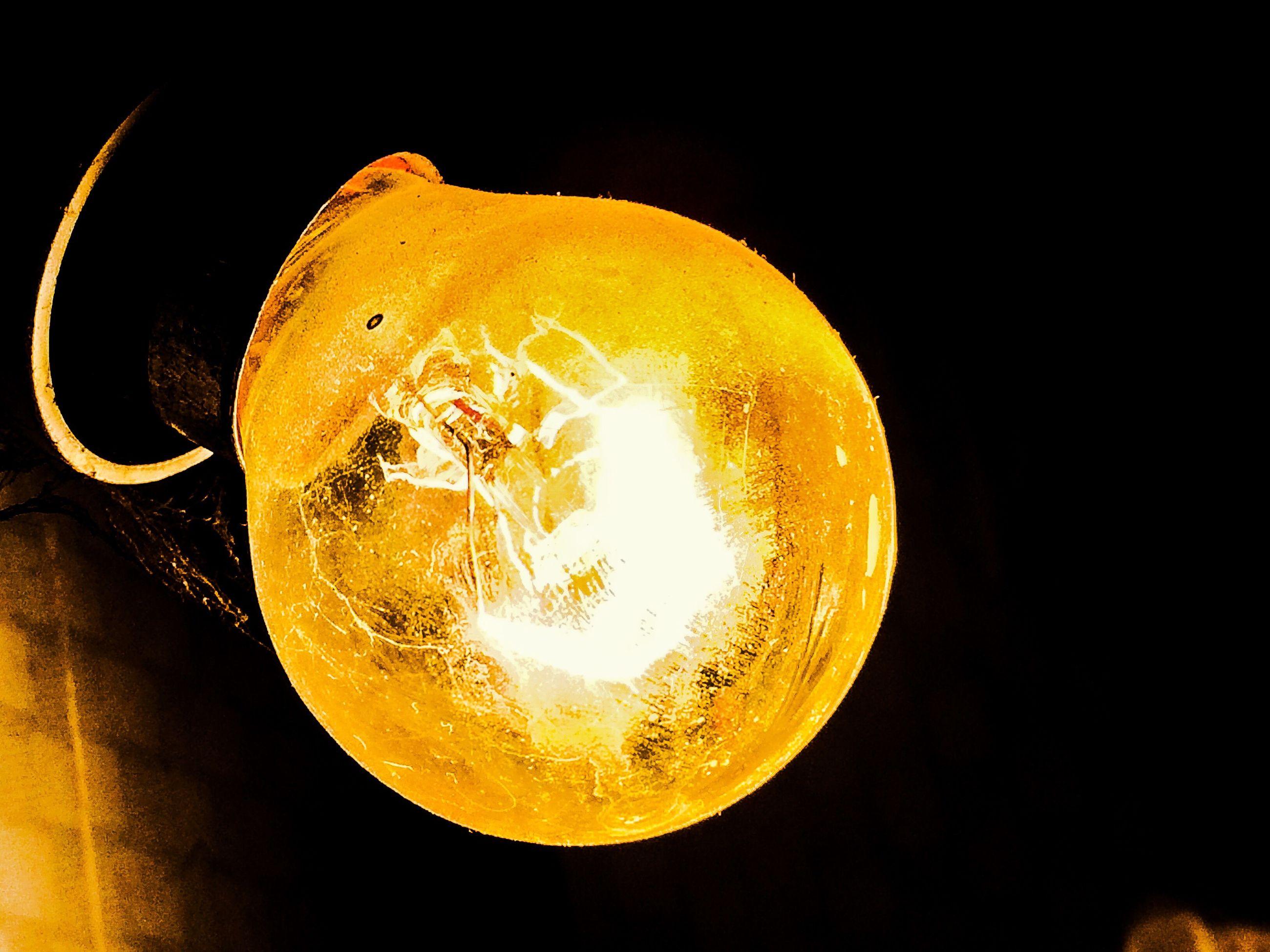 illuminated, close-up, studio shot, indoors, black background, night, yellow, glowing, still life, dark, copy space, lighting equipment, light bulb, lit, electricity, no people, single object, orange color, light - natural phenomenon, glass - material