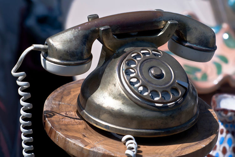 Old-fashioned phone isolated on a blurred background. Fashion Vintage Style Aged Antique Close-up Communication Connection Day Fashioned Indoors  Landline Phone No People Old-fashioned Oldest Phone Retro Styled Rotary Phone Telephone Telephone Line Telephone Lines Telephone Receiver Vintage