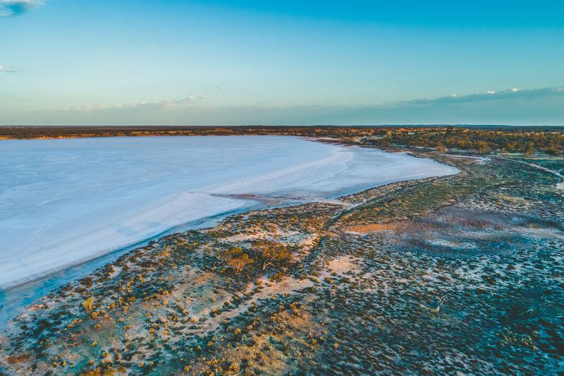 Salt lake in australian desert at dawn - aerial view