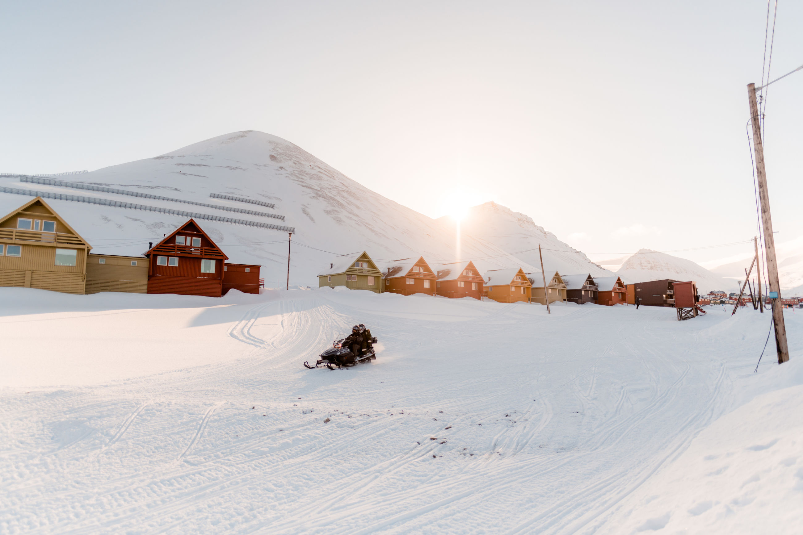 winter, snow, cold temperature, mountain, sky, built structure, architecture, covering, nature, scenics - nature, environment, building exterior, white color, beauty in nature, landscape, building, land, house, sunlight, snowcapped mountain, outdoors