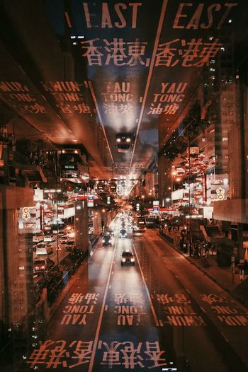 Hong Kong City Multiple Exposures Architecture Building Exterior Built Structure City City Life Communication Digital Composite Diminishing Perspective Direction Illuminated Motion Night Non-western Script Outdoors Reflection Road Script Sign The Way Forward Transportation The Creative - 2018 EyeEm Awards