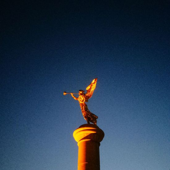 Statue Sculpture Flame Gold Colored No People Architecture Night Architectural Column Low Angle View Industry Outdoors Sky Astrology Sign Politics And Government