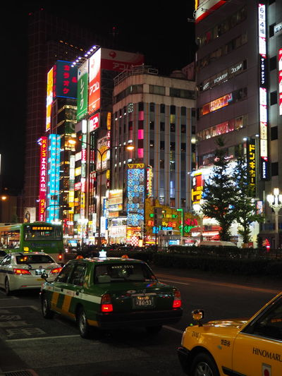 Advertisement Architecture Building Exterior Built Structure Car City City Lights Illuminated Land Vehicle Mode Of Transport Multi Colored Night No People Outdoors Road Shinjuku Street Tokyo Tokyo Night Transportation