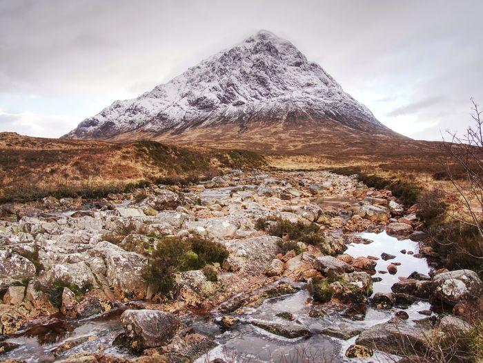 Winter trek. buachaille etive mor in glencoe, t he highlands of scotland. sunny winter day.