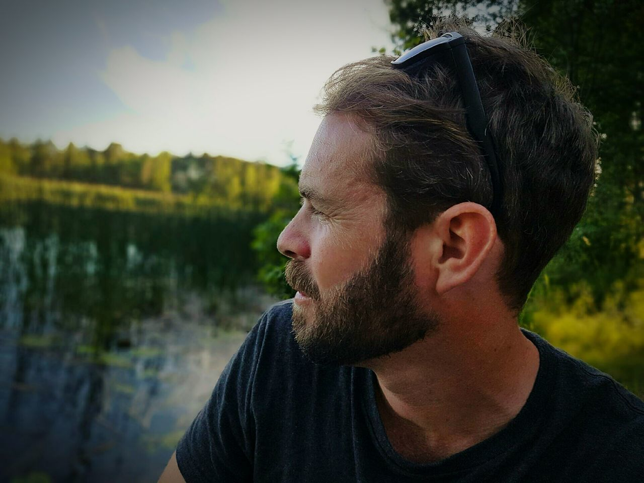 Bearded Man Looking At Lake Against Sky