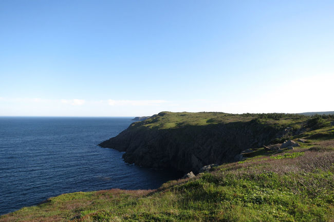 Beauty In Nature Blue Cape Spear Cliff Coastline Day Grass Horizon Over Water Idyllic Landscape Nature Newfoundland, Canada No People Non-urban Scene Outdoors Remote Rock Rock - Object Rock Formation Scenics Sea Sky Tranquil Scene Tranquility Water