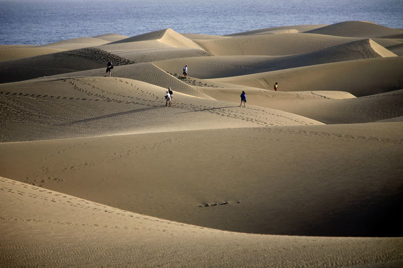 High angle view of people on desert against sea