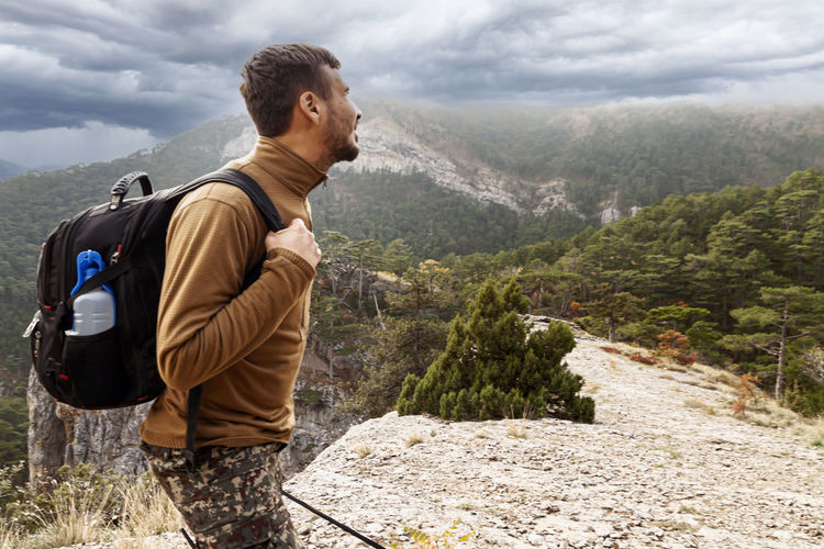 Young man looking at mountains