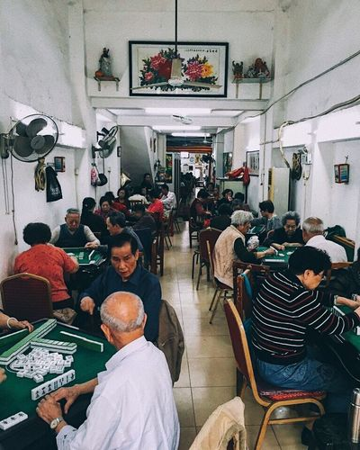 Sitting Indoors  Adults Only Real People Lifestyles People Large Group Of People Adult Eldery People Game Tablegames Guangzhou China Travel Travel Destinations Discoverchina
