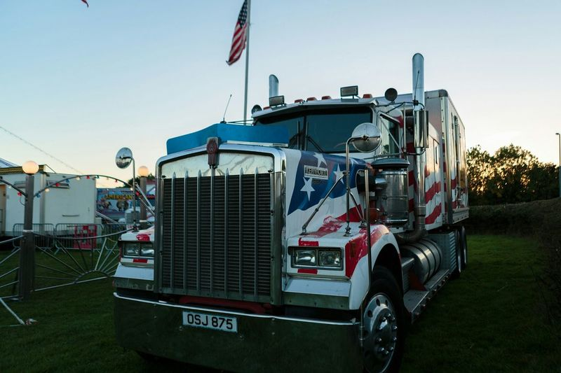 Americana truck from the American circus Tansportation Truck Golden Hour Outdoors Stars And Stripes Flag Paint Job Natural Light Big Rig Meinautomoment Photographerforhire Urban Motor Vehicle Wide Angle Low Angle View Color Photography No People