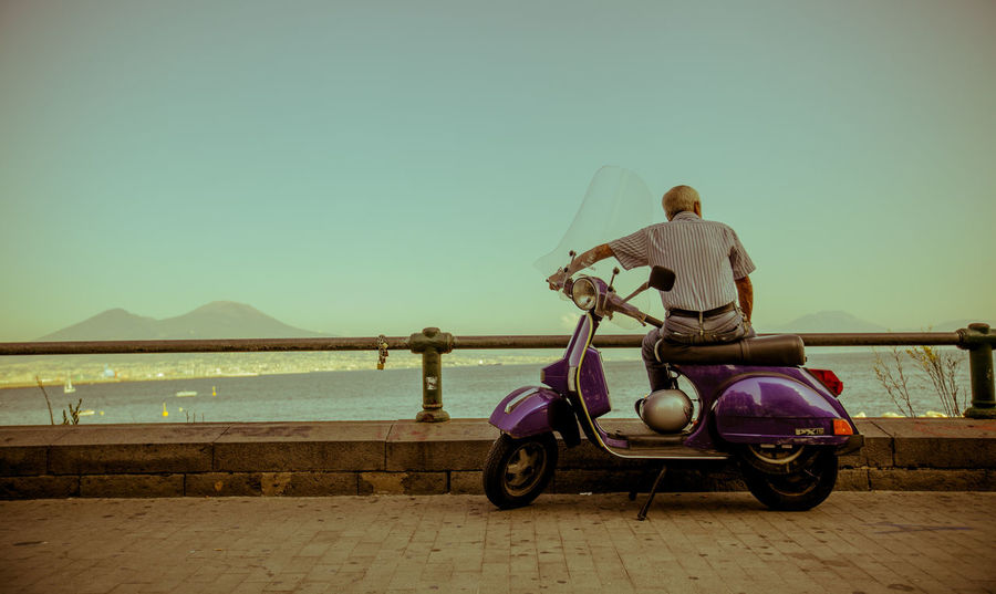 young at heart Eyem Best Shots EyeEmNewHere Eyemtravel Eyem Gallery Featured Photo Napoli Naples Italy Streetphotography #Canon Gallery Only Men Adult Adults Only Travel Mode Of Transport Men Motorcycle Land Vehicle Sitting Sea Sky Beach Outdoors Day